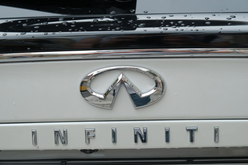 Berlin, Germany - August 31, 2017: Nissan Infiniti logo on white car. Infiniti is the luxury vehicle division of Japanese automaker Nissan Cars Logo Nissan Brand Car Editorial  Infiniti Infinity Nissan Car Nissan Infiniti Symbol