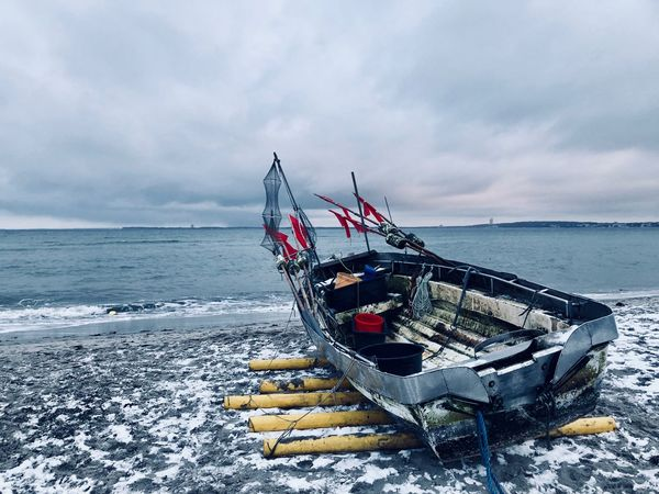 Flags Net Boat Fishing World Cold Grey Front View Collection Sunset Moody Sky Sea Horizon Over Water Beach Water Transportation Sky Nature Nautical Vessel Cloud - Sky Mode Of Transport No People Tranquility Tranquil Scene Day Sand Scenics Outdoors Beauty In Nature Moored
