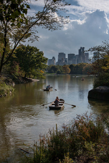 People Traveling In Boat On Lake At Central Park
