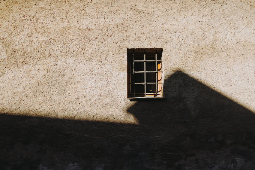 Czech Republic Sunlight Tranquility Ancient Architecture Architecture Building Building Exterior Built Structure Close-up Europe No People Old Shadow Sunlight Textured  Tourism Traditional Wall Window Window Frame Český Krumlov