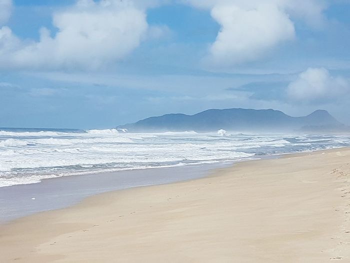Beach Sand Sea Landscape Coastline Surf Seascape Cloud - Sky Scenics Travel Destinations Dramatic Sky Wave Tranquility Tourism Nature Tranquil Scene Water Water's Edge Sunny Beauty In Nature