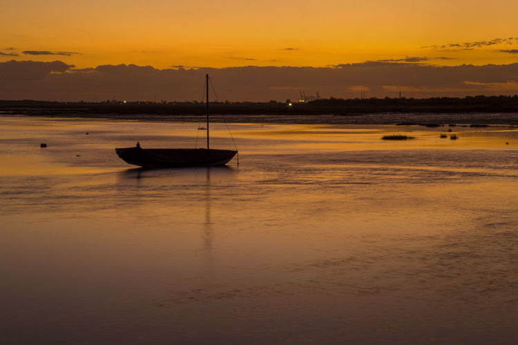 Sunset at Leigh On Sea, Essex, England Leiigh On Sea Silhouette Beach Beauty In Nature Boat England Hues Nature No People Orange Color Outdoors Purple Reflections In The Water Sand Scenics Sky Sun Sunset Water