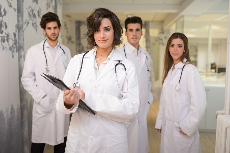 Portrait of doctors standing in hospital