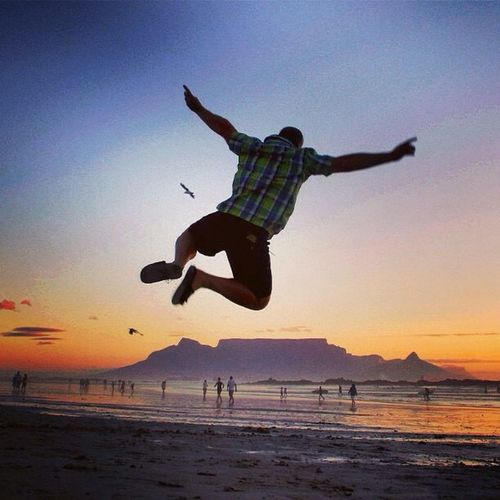 Cape Town sunsets.... Jump with a spring in your step! RBZAbigair GivesYouWings Redbullza Shooteditsleeprepeat