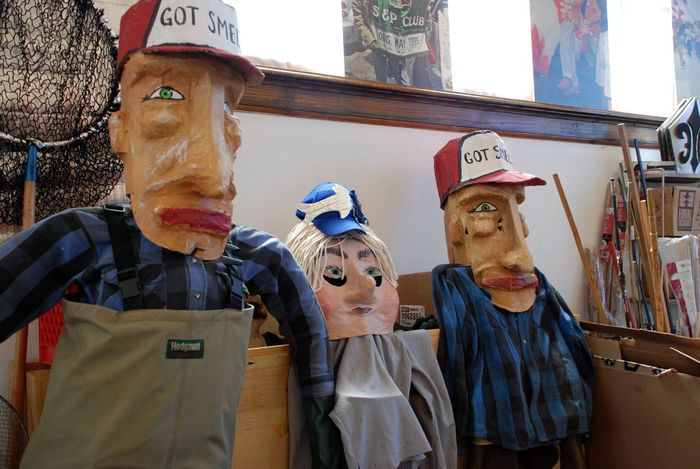 """""""Got Smelt"""". Tall puppets readied for 2017's Smelt Parade, Duluth, MN, May 14. Puppets Humor Fish Smelting Human Representation Male Likeness Text Day Communication Real People Arts Culture And Entertainment Statue Men Indoors  Witch People"""