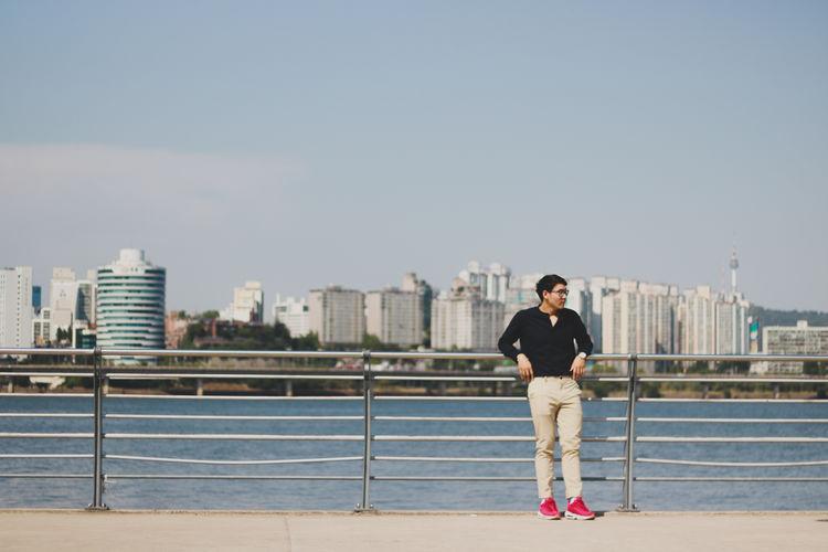 Man standing at promenade in city