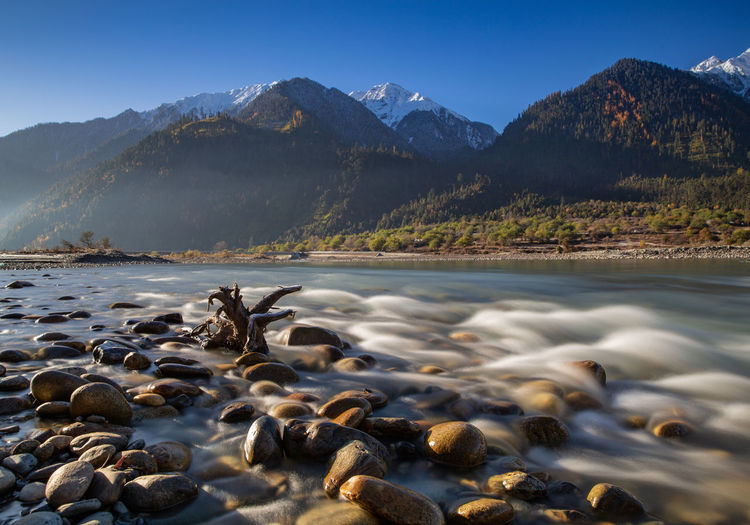 Mountain Beauty In Nature Water Scenics - Nature Sky Tranquil Scene Mountain Range Tranquility Rock Non-urban Scene Solid Nature No People Rock - Object Idyllic Day Lake Land Remote Mountain Peak Snowcapped Mountain Flowing Water River Tibet