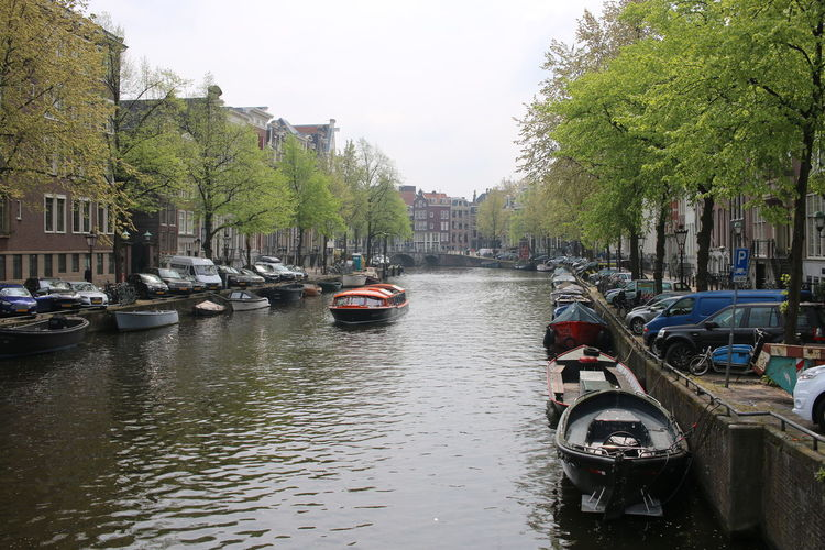 Amsterdam Canal Amsterdam Amsterdam Canal Architecture Boat Boats Building Exterior Built Structure Canal Canals And Waterways Car City Day Mode Of Transport Moored Nature Nautical Vessel No People Outdoors Sky Transportation Tree Water Waterfront