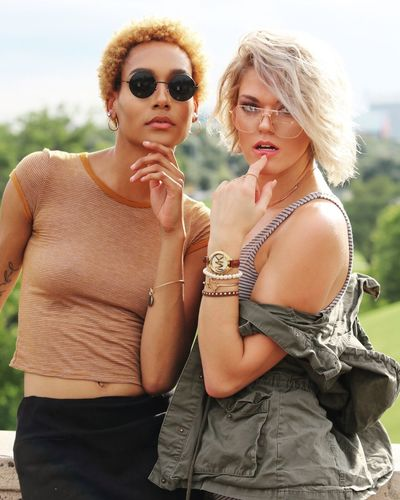 EyeEmNewHere Sunglasses Fashion Necklace Young Adult Young Women Real People Outdoors Casual Clothing Earring  Lifestyles Beautiful Woman Leisure Activity Day Attitude Fashion Model Women Blond Hair Glamour Togetherness Let's Go. Together. The Street Photographer - 2017 EyeEm Awards Portrait EyeEm Selects City Life EyeEm Selects