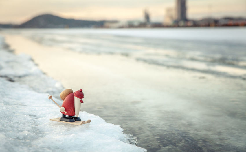 Figurine Of Santa Claus On Snow