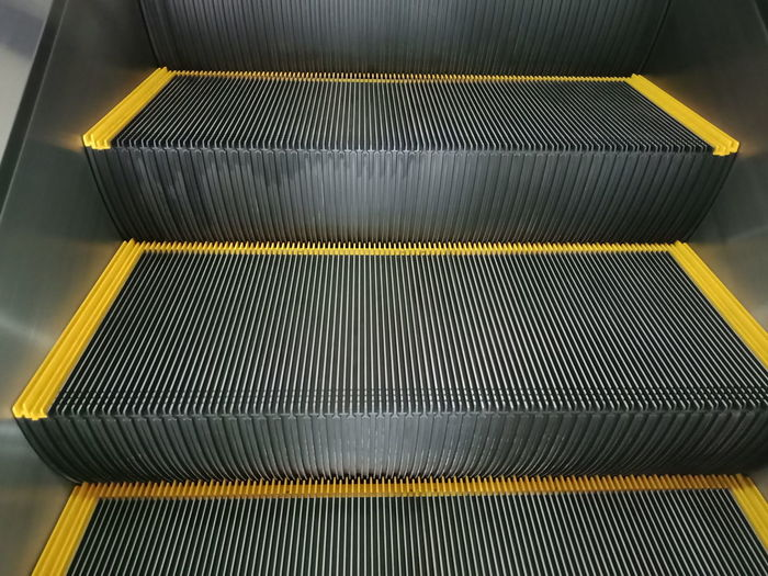 escalator Escalator Mall Manufacturing Equipment Technology Factory Industry Yellow Aluminum Production Line Metal Pattern Close-up Sheet Metal Metal Grate Alloy Platinum Metal Industry Air Duct Food Processing Plant Brushed Metal Printing Press Corrugated Corrugated Iron Steel Mill Gutter Grille Textile Factory Printing Plant Hexagon Grate