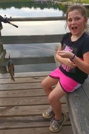 Lake Water Childhood Child Happiness Sitting Full Length Outdoors Smiling One Person Leisure Activity Day Children Only Girls Nature Action Shot  Fishing Pole Catch And Release Outdoor Activity Catching Fish Fishing Tackle Fishing Young Adult Girl Fishing Suprised