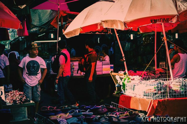 Market Stall Market People Outdoor Photography Streetphotography People Photography Multi Colored Umbrellas Light And Shadow Boy EF-S18-55mm F/3.5-5.6 IS Canon Eos 1000d 5.13.17 The Street Photographer - 2017 EyeEm Awards