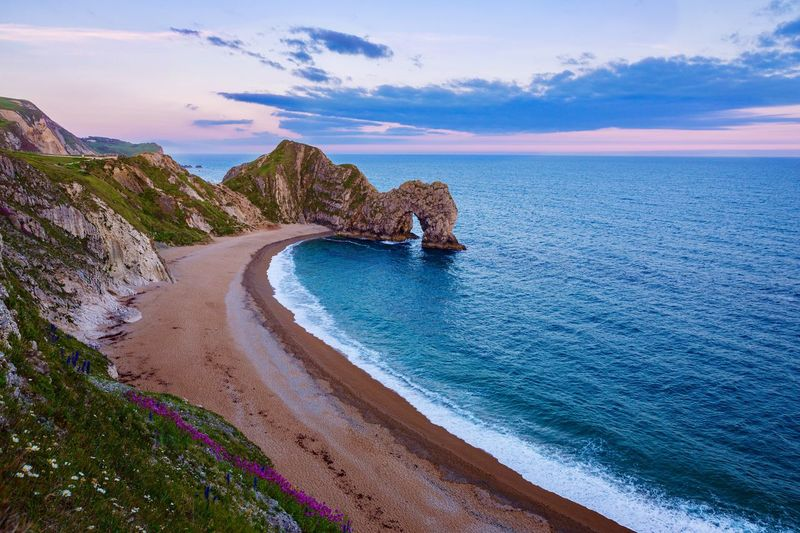 Evening at Durdle Door Dorset,England EyeEm Gallery EyeEm Selects EyeEm Nature Lover British Coastline Seaside Seascape Scenics Uk England Limestone Arch Purbeck Coast Jurassic Coast Dorset Coast Dorset Sea Water Beauty In Nature Beach Scenics - Nature Tranquil Scene Sky Horizon Over Water Tranquility Cloud - Sky Idyllic Nature Coastline Non-urban Scene Outdoors No People The Great Outdoors - 2019 EyeEm Awards
