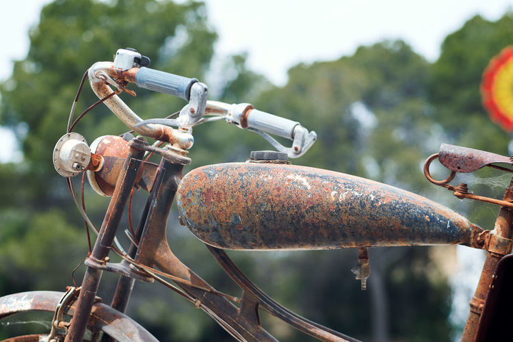 Close-up of rusty motorcycle