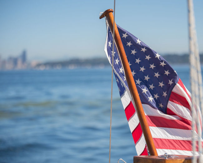 ©Amy Boyle Photography Close-up Day Flag Freedom No People Outdoors Patriotism Sky Stars And Stripes Striped Water
