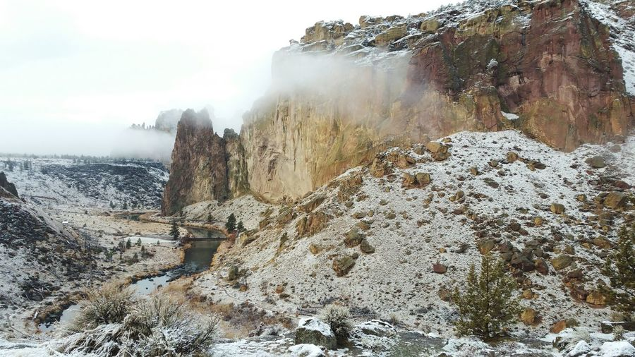 Scenic view of rock formations during foggy weather