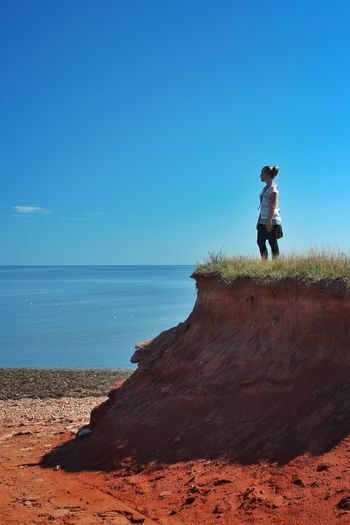 Strong Never Give Up Girl Ocean Coast Canada Adventure Thinking Looking Prince Edward Island One Person Full Length Sea Real People Childhood Leisure Activity Day Clear Sky Beach Blue Sand Water Outdoors Nature Adventure Horizon Over Water Lifestyles Sky Scenics An Eye For Travel The Traveler - 2018 EyeEm Awards