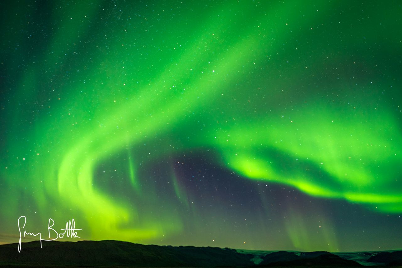 aurora polaris, beauty in nature, green color, night, nature, star - space, scenics, astronomy, tranquility, sky, outdoors, no people, tranquil scene, natural phenomenon, mountain, cold temperature, low angle view, landscape, illuminated, winter, space, galaxy