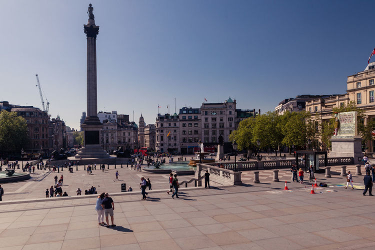 Trafalgar Square, a walk around the square Nelson's Column Architecture Building Exterior Built Structure City Clear Sky Crowd Group Of People History Large Group Of People Men Nature Outdoors Real People Sky The Past Tourism Tourist Trafalgar Square Travel Travel Destinations Women