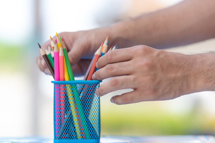 Art And Craft Body Part Childhood Close-up Creativity Day Finger Focus On Foreground Hand Holding Human Body Part Human Hand Human Limb Leisure Activity Lifestyles Men Multi Colored One Person Outdoors Paper Real People