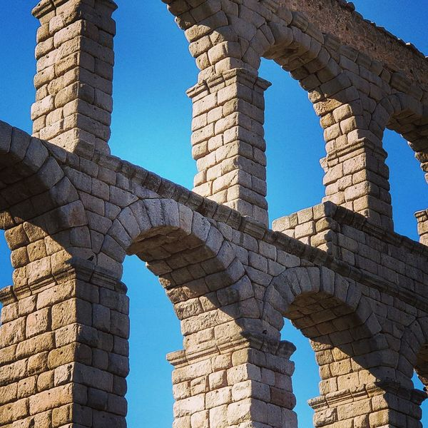 EyeEm Selects Arch Architecture History Built Structure Outdoors Roman Architecture Roman Aqueduct Acueducto Acueducto De Segovia Outdoor Photography Architectural Detail Old Ruin Day Travel Destinations No People Sky