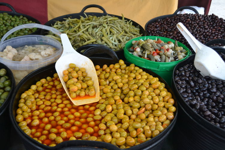 High Angle View Of Olives With Food In Containers For Sale In Market