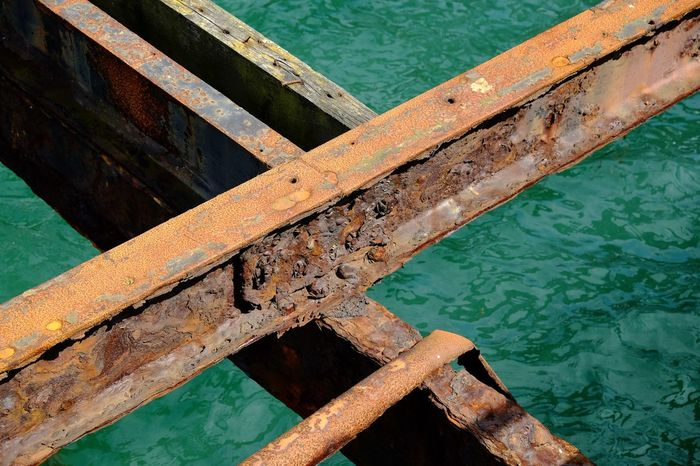 High Angle View Harbor Close-up Sea Day Rusty Metal Orange Color Green Color Structures & Lines Beams Decaying Structure