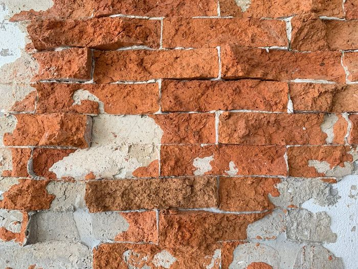 Wall - Building Feature Brick Wall Brick Wall Built Structure Architecture Textured  Backgrounds Full Frame No People Day Pattern Weathered Old Rough Building Exterior Construction Material Damaged Close-up Brown Outdoors Concrete Cement