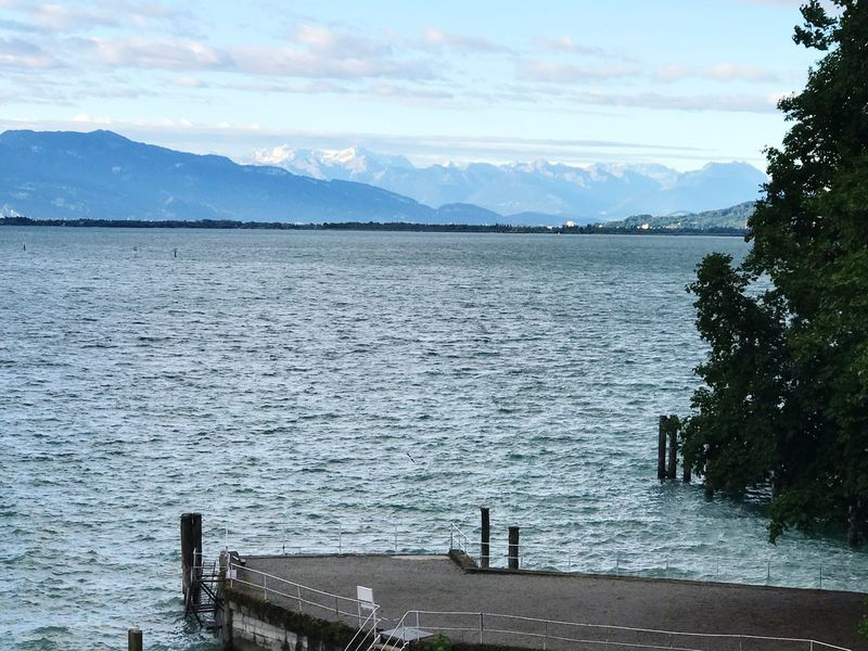 Let's Go. Together. Water Sea Scenics Tranquil Scene Tranquility Nature Sky Pier Beauty In Nature Day Mountain Outdoors Tree Cloud - Sky Jetty No People Mountain Range Harbor Lindau Bodensee Lindau