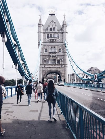 People on walking on tower bridge against sky