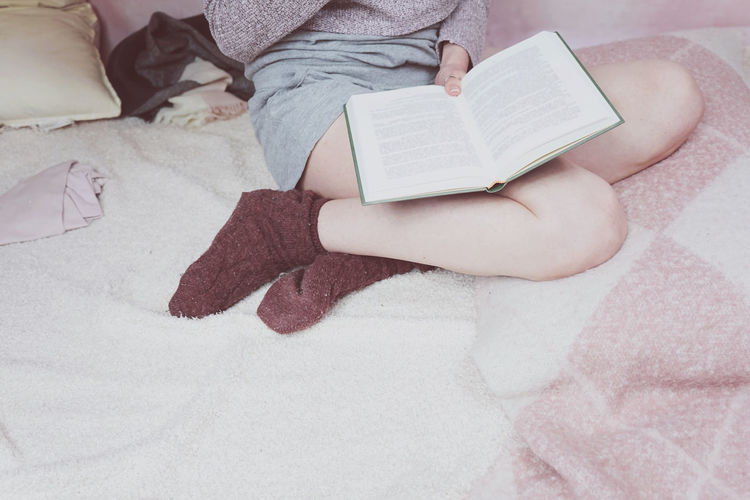 Book Publication One Person Bed Real People Indoors  Furniture Low Section Education Relaxation Reading Activity Holding Human Body Part Lifestyles Leisure Activity Women Casual Clothing High Angle View Hand Studying KAWAII Socks Intelligence Literature