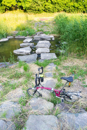 High angle view of bicycle on field by lake