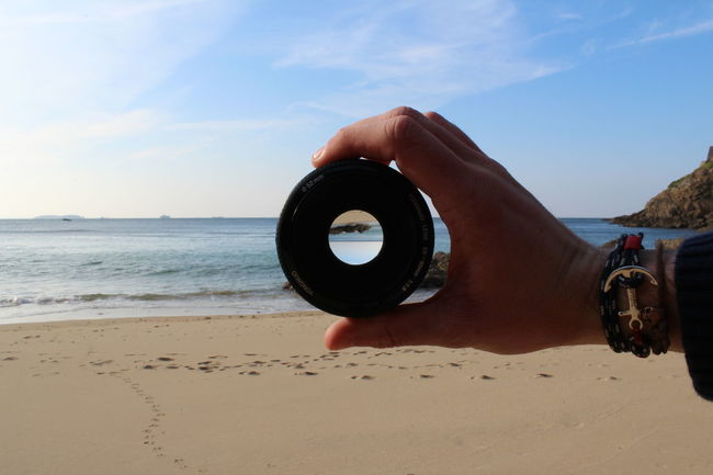 Adult Adults Only Beach Beauty In Nature Camera - Photographic Equipment Close-up Day Eyesight Horizon Over Water Human Body Part Human Hand Nature One Person Outdoors People Photographer Sand Sea Sky