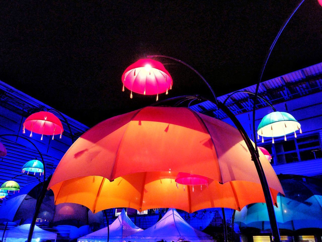 illuminated, lighting equipment, night, umbrella, protection, no people, security, multi colored, low angle view, hanging, outdoors, celebration, decoration, nature, parasol, design, pattern, architecture, purple