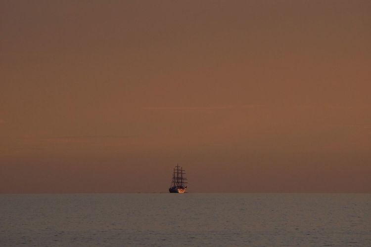 Ship Sailing In Baltic Sea During Sunset