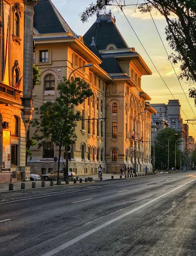 Sunset #sun #clouds #skylovers #sky #nature #beautifulinnature #naturalbeauty #photography #landscape Bucharest, Romania #traveldestinations Building Exterior City Architecture Built Structure Street Road City Street Building Nature Sky