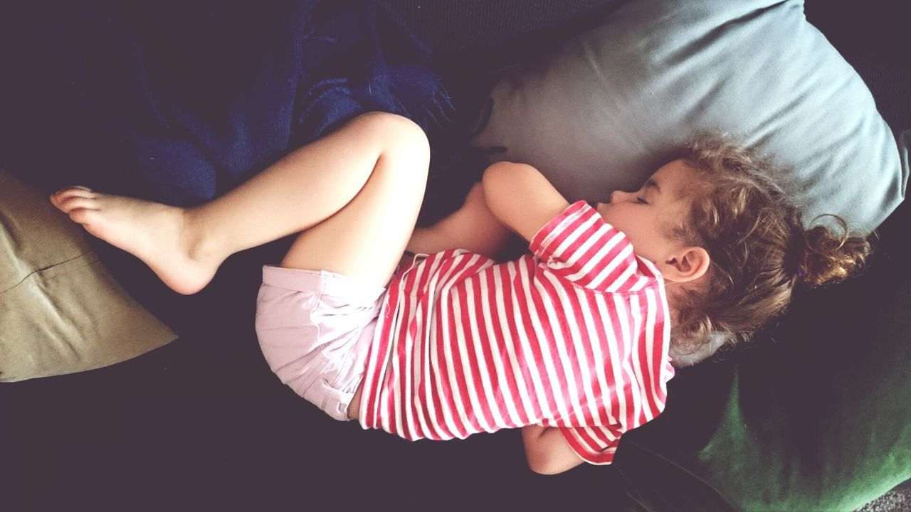 Little girl sleeping on sofa