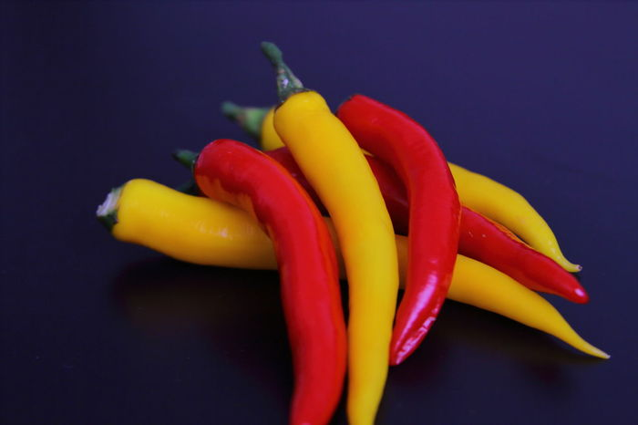 Black Background Close-up Colorful Freshness Green Color Hot Peppers Malaguetas Multi Colored No People Orange Color Organic Peppers Red Red Chillies Selective Focus Still Life Studio Shot Yellow Yellow Chillies