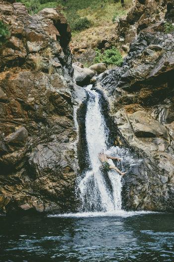 Man enjoying waterfall