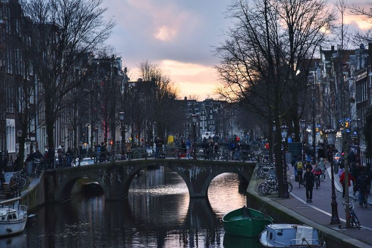 Daily life Amsterdam Amsterdamcity City Life City Street Eye4photography  EyeEm Gallery Daily Life Travel Destinations Travel Photography EyeEm Winter Wintertime City Canal Reflection See What I See Tree City Sunset Sky Architecture Bridge - Man Made Structure Arch Bridge Canal Boat