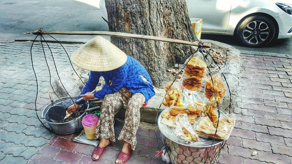 Hanging Hat Adults Only Outdoors Day People One Person Culture Hat Food Streetfood Stretphotography Workingwomen Saigon, Vietnam