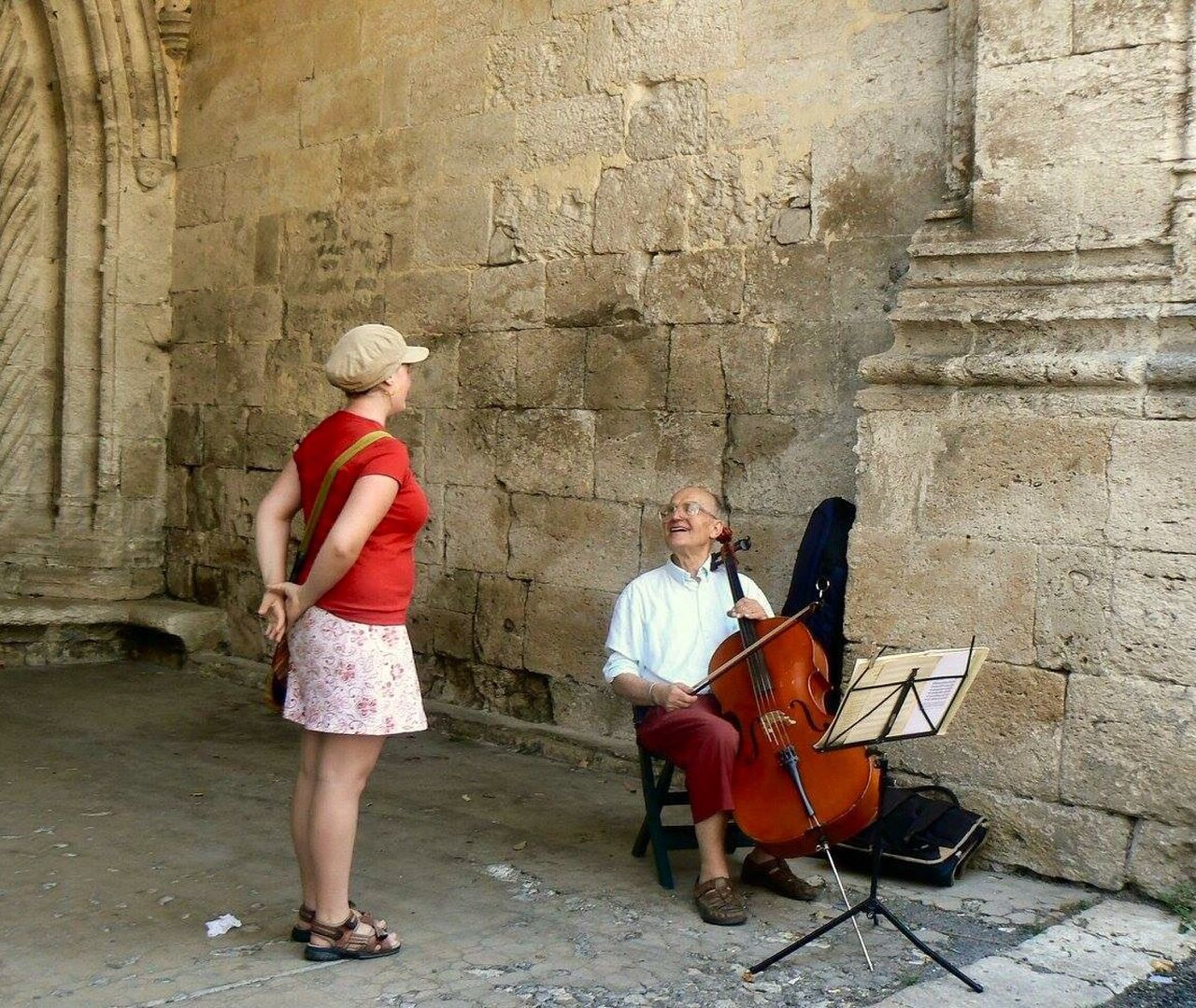 two people, full length, sitting, men, mature men, mature adult, music, adult, day, young women, architecture, women, young adult, built structure, musician, adults only, musical instrument, red, outdoors, togetherness, real people, people, ancient civilization