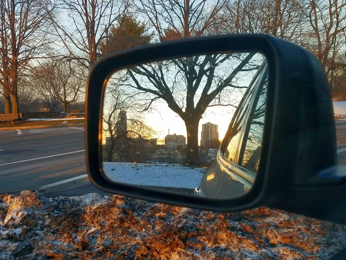 Mirror reflection of New Rochelle's downtown skyline (2/18/2018) Side-view Mirror Car Mirror Reflection Vehicle Mirror Transportation Tree Close-up Sunset
