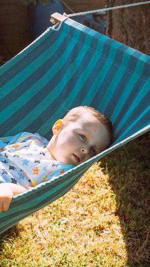 Portrait of boy lying on hammock