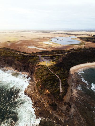 Where the farmland meets the sea. IG @noeldxng Australia Farmland Rural Aerial Drone  Dji Water Sea Beach Sand Sky Horizon Over Water Landscape Rushing Wave Rocky Coastline Crashing Seascape Rugged Power In Nature Geology Coast Shore Surf Tide Low Tide The Great Outdoors - 2018 EyeEm Awards A New Beginning Capture Tomorrow