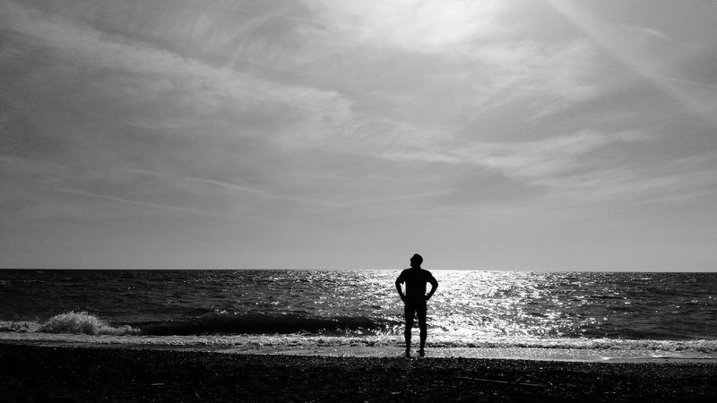 A contemplative man Man Contemplating Seascape Tuscany Under The Tuscan Sun Hot Spring Landscape Sunset Relax Blackandwhite Alone Love Mylove Bibbona  Water Sea Beach Wave Standing Silhouette Men Childhood Boys