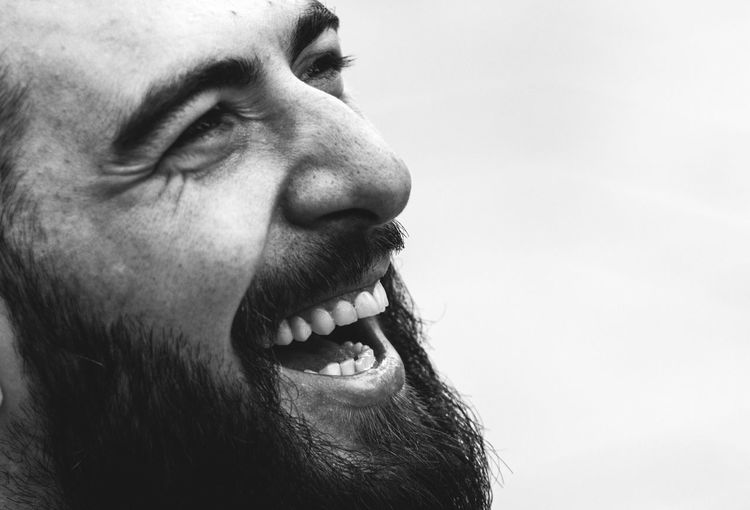 Close-up bearded man against white background