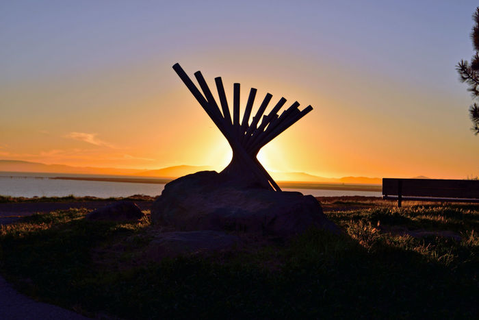 Sunset @ Oyster Bay Pt 4 San Leandro,Ca. Stainless Steel Sculpture Rising Wave 16 Poles Artist: Roger Berry All About Angles Sunset Sunset Silhouettes Sunset Collection Scenic Pier Marin Headlands San Francisco Bay Silhouettes Boulder Wooden Bench Sunset Photography Landscape_Collection Landscape_photography Sun's Glow Sun Over The Horizon Vista Nature Beauty In Nature Hilltop