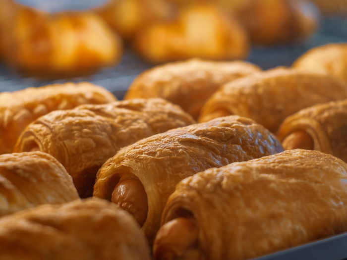 Close-up of croissants in bakery for sale